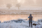 UNITED KINGDOM, London: 22 November 2018 An early morning walker stops to take a picture during a frosty Richmond Park during sunrise this morning. Temperatures sunk to zero degrees in the capital last night. Rick Findler  / Story Picture Agency