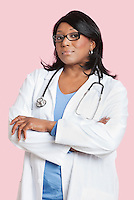 Portrait of confident mixed race female surgeon over pink background