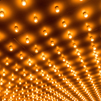 Picture of theater marquee lights with rows of lightbulbs on a theatre entrance. Also commonly known as casino and broadway lights.