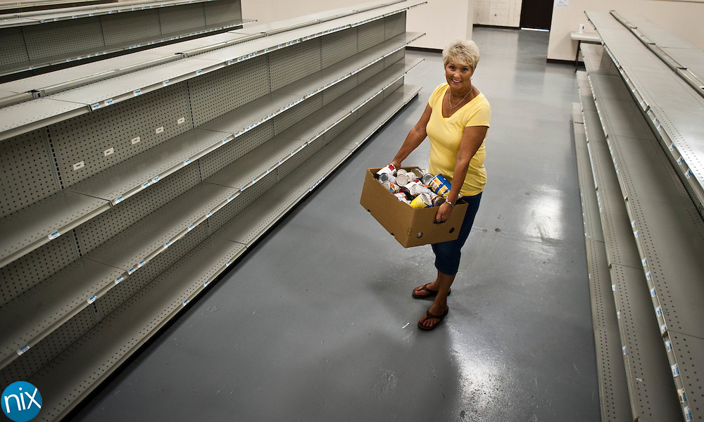 Martha Jackson, a volunteer with Concord First Assembly, at the church's newly expanded food panty. The pantry will open next week with fully stocked shelves.