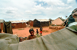 A refugee camp outside the capital of Luanda in Angola is shown in this file photo.  President Jose Eduardo dos Santos, who has led Angola since 1979, said he would not run in presidential elections planned for next year.  Angola's brutal 26 year-civil war has displaced around two million people - about a sixth of the population - and 200 die each day according to United Nations estimates. .(Photo by Ami Vitale)