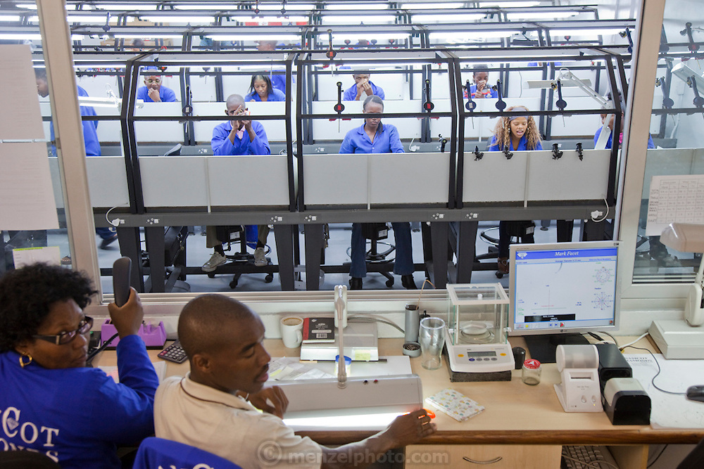 Supervisors coordinate operations in a diamond polishing  factory at NamCot Diamonds in Windhoek, Namibia. Diamonds are one of Namibia's major exports, and  while conflict diamonds grab the headlines, the fact is that the industry does provide a fairly decent living for many.