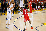 Golden State Warriors guard Stephen Curry (30) crosses Houston Rockets guard James Harden (13) during Game 3 of the Western Conference Finals at Oracle Arena in Oakland, Calif., on May 20, 2018. (Stan Olszewski/Special to S.F. Examiner)