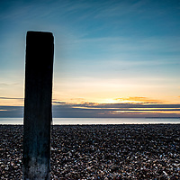 Beach view of sunset across the sea in England