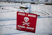 Warning for mines at the Sarajevo Tunnel museum, also known as Tunel spasa (English: Tunnel of rescue) and Tunnel of Hope, which was an underground tunnel constructed between March and June 1993 during the Siege of Sarajevo in the midst of the Bosnian War. It was built by the Bosnian Army in order to link the city of Sarajevo, which was entirely cut off by Serbian forces, with Bosnian-held territory on the other side of the Sarajevo Airport, an area controlled by the United Nations. The tunnel linked the Sarajevo neighbourhoods of Dobrinja and Butmir, allowing food, war supplies, and humanitarian aid to come into the city, and allowing people to get out. The tunnel became a major way of bypassing the international arms embargo and providing the city defenders with weaponry.