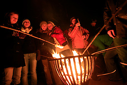 GERMANY SCHLESWIG HOLSTEIN ECKERNFOERDE 26DEC09 - Camp fire at the south beach in Eckernfoerde, an annual local christmas tradition. People grill sausages and bread on sticks over the flames. ..jre/Photo by Jiri Rezac
