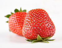 Strawberries on white background - close-up