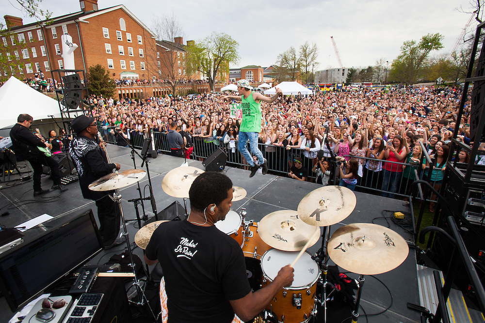 Thousands of Ohio University tudents pack in close to the stage to watch Aaron Carter's performance on South Beach April 24, 2014. The celebration was organized by the University Program Council.  Photo by Jonathan Adams / Ohio University