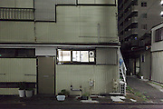 from inside lighted up window of residential house Japan