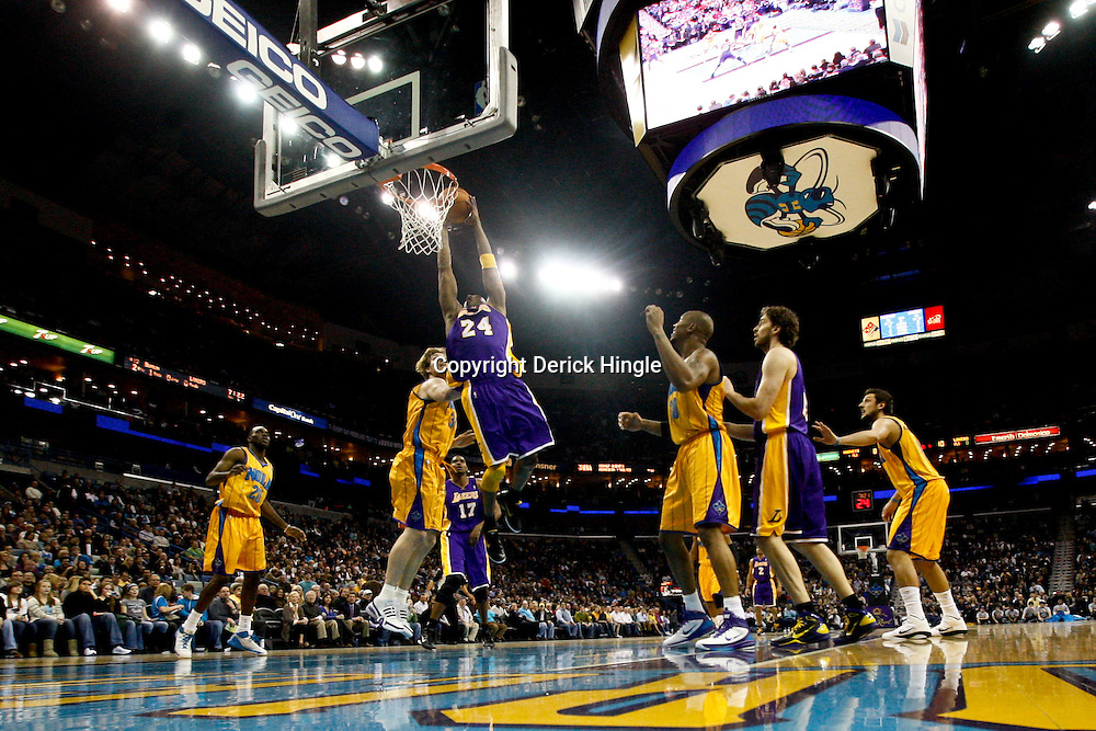 February 5, 2011; New Orleans, LA, USA; Los Angeles Lakers shooting guard Kobe Bryant (24) dunks against the New Orleans Hornets during the first quarter at the New Orleans Arena. The Lakers defeated the Hornets 101-95.  Mandatory Credit: Derick E. Hingle