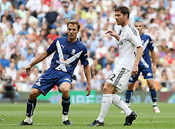 Real Madrid's Xabi Alonso (r) and Tenerife's Mikel Alonso (l) during La Liga match.September 2 2009.