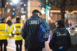 "© Licensed to London News Pictures . 17/12/2016 . Manchester , UK . Street Pastors outside the Printworks . Revellers out in Manchester City Centre overnight during "" Mad Friday "" , named for being one of the busiest nights of the year for the emergency services in the UK . Photo credit : Joel Goodman/LNP"