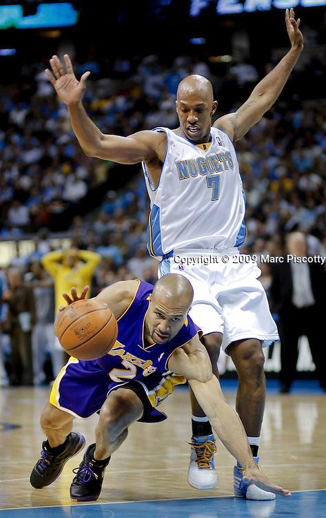 The Los Angeles Lakers' Derek Fisher (#2) trips as he tries to drive past the Denver Nuggets' Chauncey Billups (#7) during the first half of their NBA Western Conference Finals playoff basketball game at the Pepsi Center in Denver, Co. May 23, 2009. .(Photo by Marc Piscotty / © 2009)