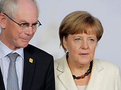 © Licensed to London News Pictures. 05/06/2014. Brussels, BELGIUM.<br /> Angela Merkel (r) and Herman Van Rompuy at the G7 SUMMIT Family Photo, 5/6/2014<br /> . Photo credit : RICH BOWEN/LNP