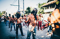 Holy Week in Pampanga province in the Philippines. During the Holy Week festival, many devote Catholics walk the streets whipping themselves and shedding blood to atone for their sins and to ask forgiveness from their God.