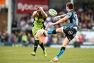 Glenn Dickson of Northampton Saints charges down a kick from Henry Slade (right) of Exeter Chiefs  during the LV Cup Final match at Sandy Park, Exeter<br /> Picture by Andy Kearns/Focus Images Ltd 0781 864 4264<br /> 16/03/2014