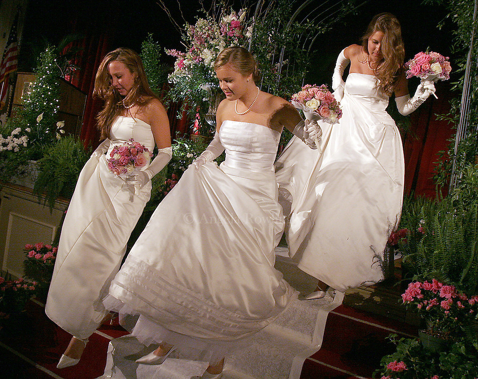 06/16/06 Boston, MA-- Amanda McGuire, 18, of Boston, left, Victoria Morphy, 18, and her twin Katherine, make their way down from the stage after a formal portrait prior to the Boston Cotillion.  (061606cotillionar04, saved in adv news, Staff Photo by Angela Rowlings)