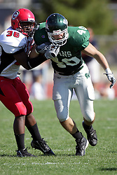 04 October 2008: Earl Jackson gets some of John Meacham's face mask in a battle between the Carthage Red Men and the Illinois Wesleyan University Titans, Game action was at Wilder Field on the campus of Illinois Wesleyan University in Bloomington Illinois.