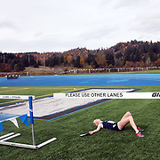Hood River Valley's Grace Grim collapses after winning the OSAA 5A Cross Country Championships at Lane Community College in Eugene.