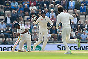 Wicket - Jos Buttler of England celebrates after Ravichandran Ashwin of India is bowled by Moeen Ali of England during day two of the fourth SpecSavers International Test Match 2018 match between England and India at the Ageas Bowl, Southampton, United Kingdom on 31 August 2018.
