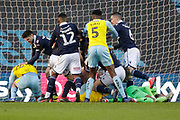 Millwall midfielder Ben Marshall (44) pushes Rotherham United forward Michael Smith (24) back during a goalmouth skirmish during the EFL Sky Bet Championship match between Millwall and Rotherham United at The Den, London, England on 2 February 2019.
