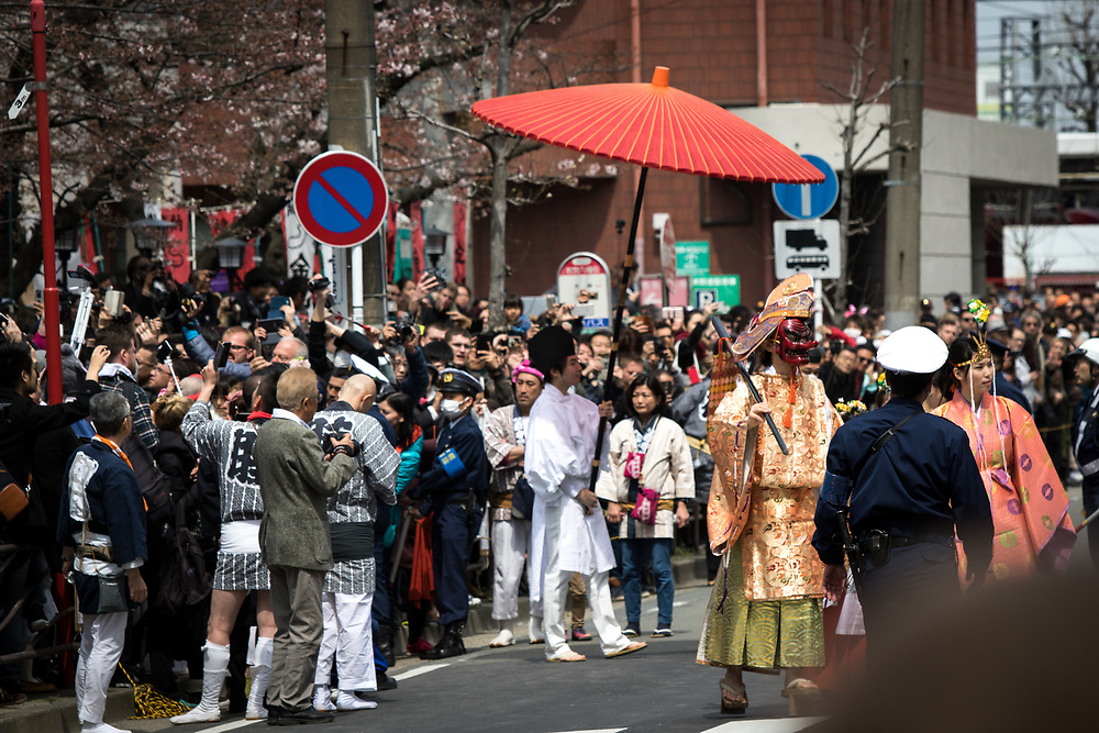 KAWASAKI, JAPAN - APRIL 2 : Participants of the festival parades during the annual Kanamara Festival in Kanayama Shrine on April 2, 2017 in Kawasaki, Japan. The fertility festival, originated from prostitutes who wished to pray for good business and protection from sexually transmitted diseases, nowadays, celebrates for fertility, relationships and safe sex practices, including AIDS prevention. Attracted with Tens of thousands festival goers including tourist, people can buy penis shape candies, key chains, trinkets, pens, chocolates and even toy glasses with a plastic penis nose. (Photo by Richard Atrero de Guzman/NUR Photo)