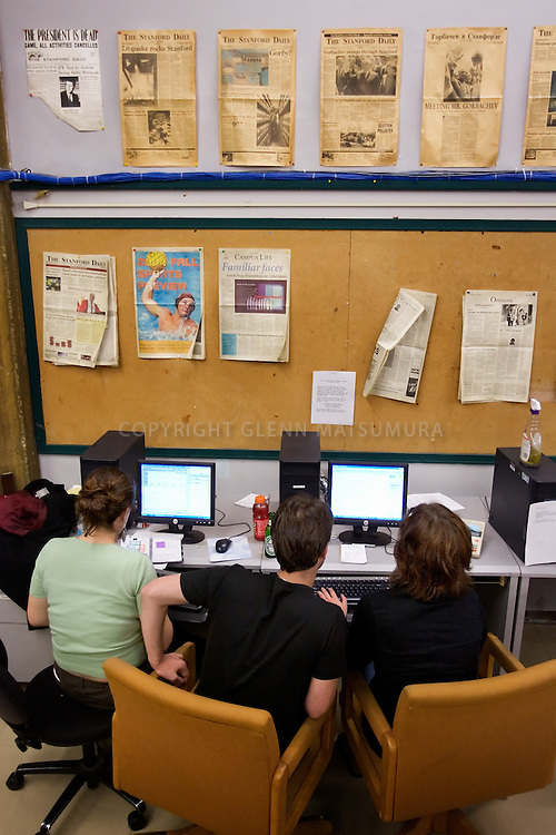 Stanford after dark. Stanford Daily staff work on the next day's issue. L-R, Sara Inés Calderéon (05), Simon Shuster (05), Camille Ricketts (06).