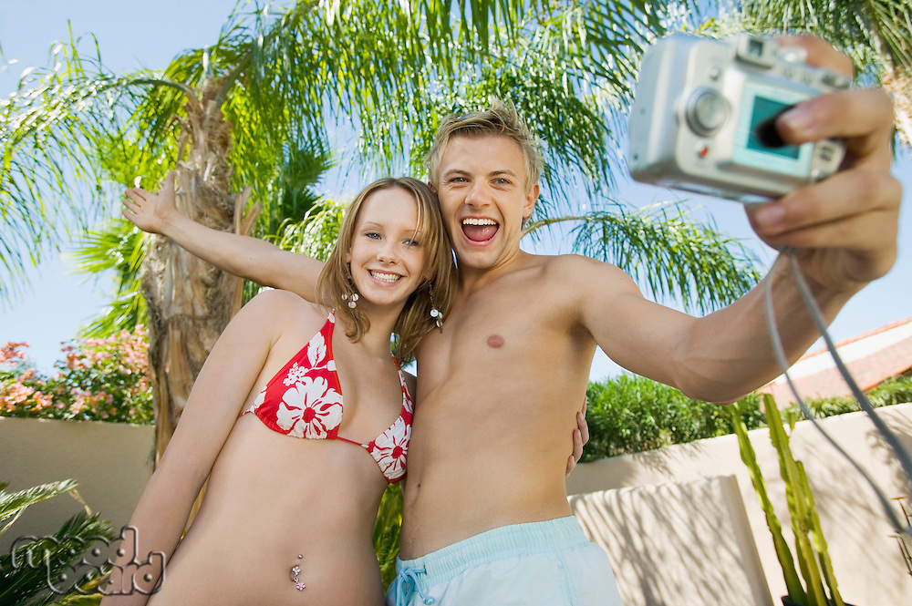 Couple Posing For Digital Camera Photo