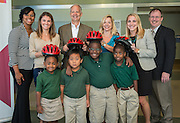 Houston ISD, Bush Foundation, Price Waterhouse Cooper and Elves and More staff present four students from Foerster Elementary School with bicycles for completing a summer literacy program, September 24, 2014.