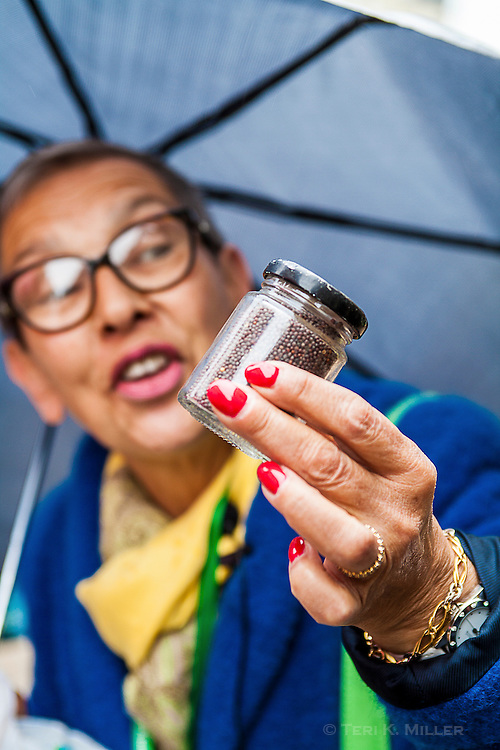 A tour guide holds up a jar of mustard seeds in Dijon, France.