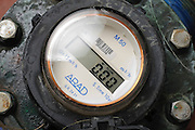 Water flow meter with digital display measures the hourly flow of the water in cubic metres