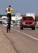 25 year old Neil Sauter walks along U.S. 31 toward Charlevoix, MIchigan during his walk on stilts across Michigan to raise money and awarness for Cerebral Palsy.  Suater is walking from Toledo, Ohio to Ironwood, Michigan and hopes to raise $10,000.00.