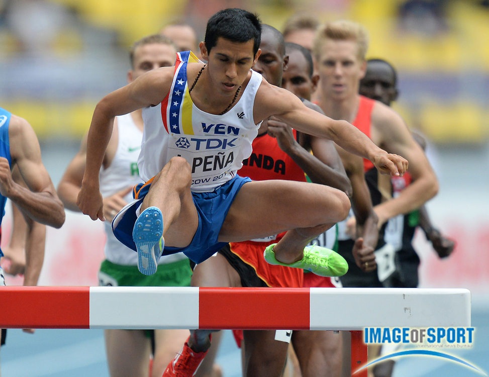 Aug 12, 2013; Moscow, RUSSIA; Jose Pena (VEN) hurdles a barrier in a steeplechase heat in the 14th IAAF World Championships in Athletics at Luzhniki Stadium.