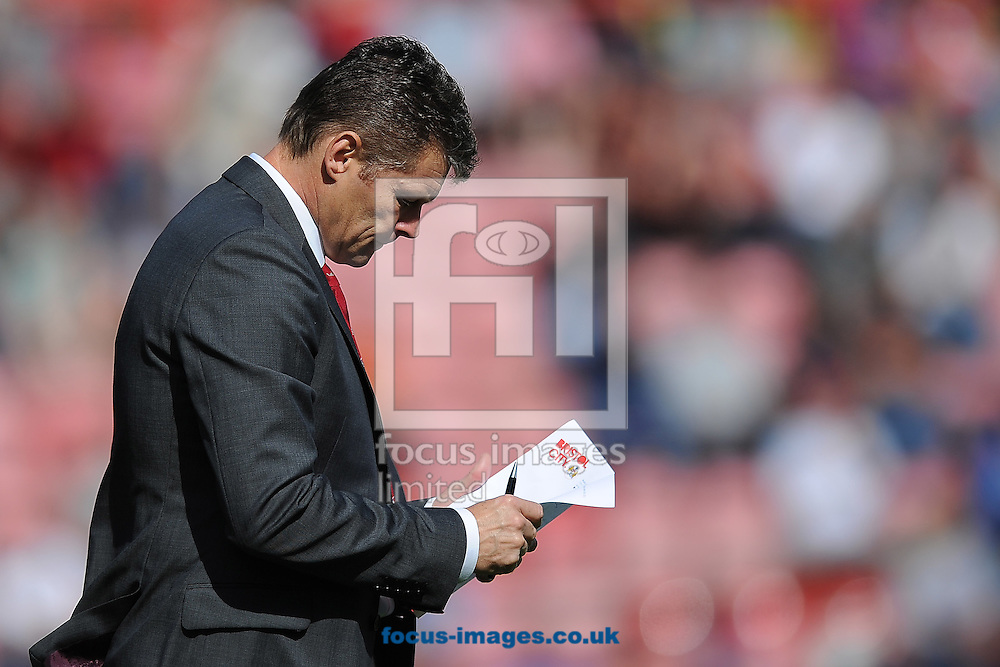 Steve Cotterill, Manager of Bristol City looks at his notes during the Sky Bet League 1 match at Ashton Gate, Bristol<br /> Picture by Richard Blaxall/Focus Images Ltd +44 7853 364624<br /> 16/08/2014