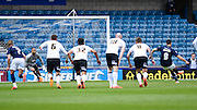 Lee Gregory scores from the spot to put Millwall 2-0 up during the Sky Bet Championship match between Millwall and Derby County at The Den, London, England on 25 April 2015. Photo by David Charbit.