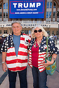 Daryl and Elke Davis wait outside to hear presidential candidate Donald Trump speak during a rally at the American Airlines Center in Dallas, Texas on September 14, 2015. (Cooper Neill for The New York Times)