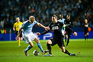 25.11.2015. Malmö, Sweden. <br /> Franz Brorsson (L) of Malmö FF fights for the ball with Zlatan Ibrahimovic (R) of Paris during the UEFA Champions League match at the Malmö Stadium. <br /> Photo: © Ricardo Ramirez.