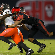 10 November 2018: San Diego State Aztecs cornerback Darren Hall (23) brings down UNLV Rebels running back Lexington Thomas (3) after a short gain in the third quarter. The Aztecs lost 27-24 to UNLV Saturday night at SDCCU Stadium falling a game behind Fresno State in the conference standings.