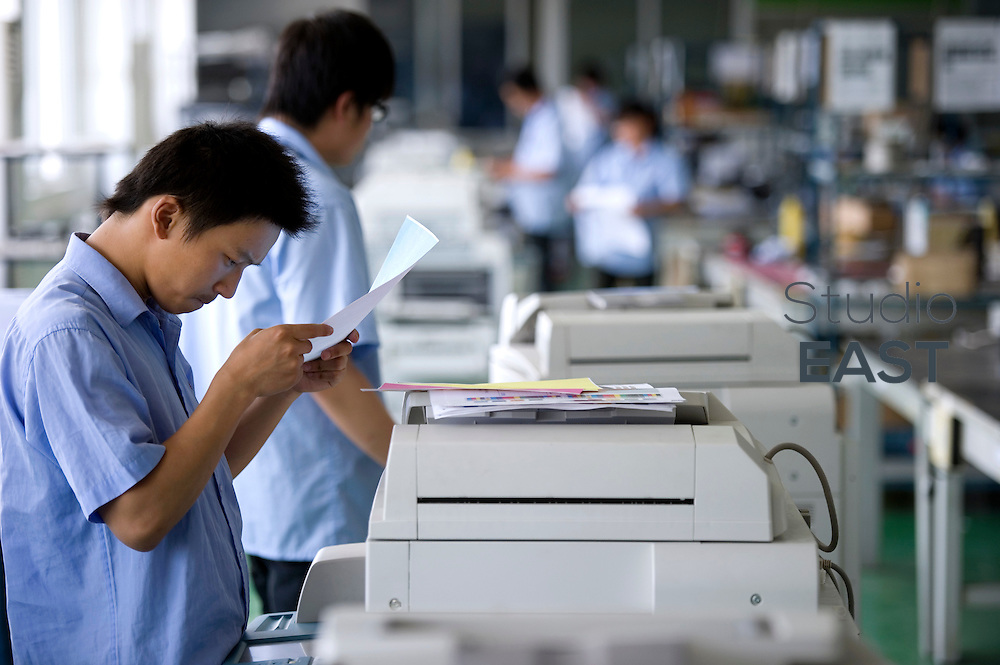 Workers check prints' quality of remanufactured second-hand copiers in Ecostar factory, near Nanjing, Jiangsu province, China, on June 7, 2010. Photo by Lucas Schifres/Pictobank