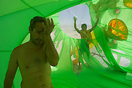 BLACK ROCK CITY, NV:  Csaba Borza wipes sweat and dust from his face while standing inside a giant inflatable brain that was later taken down due to high winds in Black Rock City, Nevada. Temperatures are often above 100 F in the Black Rock Desert during this time of year. (Model Released)
