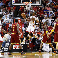 24 January 2012: Miami Heat power forward Chris Bosh (1) goes for the reverse lay up during the Miami Heat 92-85 victory over the Cleveland Cavaliers at the AmericanAirlines Arena, Miami, Florida, USA.