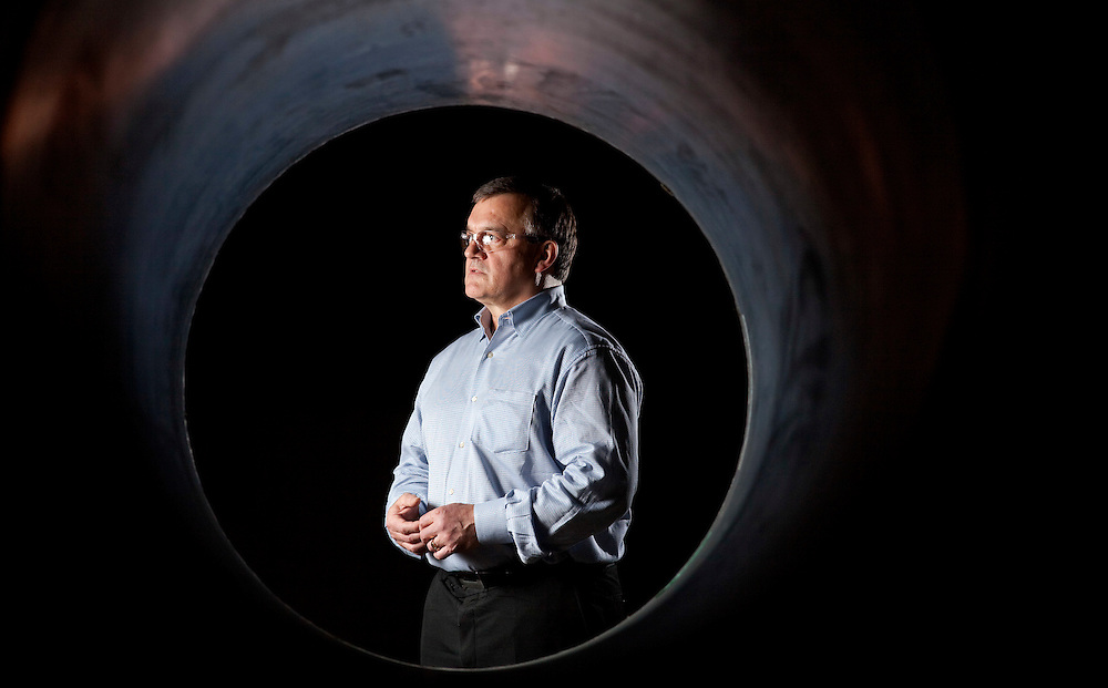 Tilbury, Ontario ---10-01-06--- Paul Giannelia, CEO of RS Technologies is framed through one of the company's composite utility poles at their manufacturing plant in Tilbury, Ontario. <br /> GEOFF ROBINS The Globe and Mail