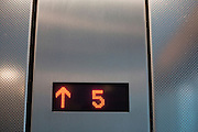 A lift (elevator) shows it is ascending to the top floor number 5 at Heathrow airport's Terminal 5.