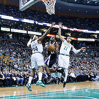 30 January 2013: Sacramento Kings point guard Tyreke Evans (13) goes for the layup past Boston Celtics shooting guard Courtney Lee (11) and Boston Celtics small forward Paul Pierce (34) during the Boston Celtics 99-81 victory over the Sacramento Kings at the TD Garden, Boston, Massachusetts, USA.
