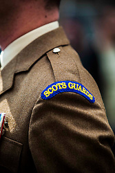 The 1st Battalion Scots Guards paraded down the Royal Mile today after receiving the Freedom of the City of Edinburgh to celebrate their return from a tour of duty in Afghanistan.<br /> ©Michael Schofield.