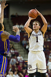 Texas A&M forward DJ Hogg (1) shoots a three point shot against LSU during the first half of an NCAA college basketball game Saturday, Jan. 6, 2018, in College Station, Texas. (AP Photo/Sam Craft)