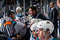 KELOWNA, CANADA - MARCH 3:  Referee Tyler Adair speaks to Kelowna Rockets' head coach Adam Foote at the bench against the Portland Winterhawks on March 3, 2019 at Prospera Place in Kelowna, British Columbia, Canada.  (Photo by Marissa Baecker/Shoot the Breeze)