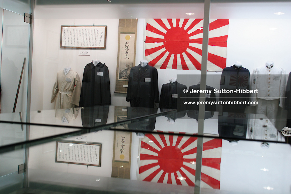 KAMIKAZE MUSEUM. Military uniforms and the Hinomaru, Japanese flag, on display at the Special Attack Peace Memorial Museum, in Chiran, Kyushu Island, Southern Japan. Chiran was the airbase from where kamikaze pilots took off on their final missions.