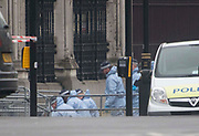 UNITED KINGDOM, London: 23 March 2017 A forensics team starts a search outside the front gates of Houses of Parliament this morning after a terror attack which killed four people including the attacker in Westminster yesterday. Rick Findler / Story Picture Agency