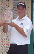 Grand Traverse Resort pro Scott Hebert accepts his trophy for winning the 2009 Michigan PGA Tournament of Champions.